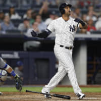 New York's Aaron Hicks watches his three-run homer against Toronto leave the yard in the fifth inning on Monday night.