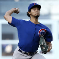 Cubs starter Yu Darvish pitches against the Dodgers on Saturday at Dodger Stadium in Los Angeles. Darvish struck out 10 in the Cubs' 2-1 victory over his former team.