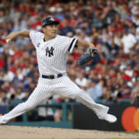Masahiro Tanaka, of the New York Yankees, pitches during the second inning of the MLB All-Star Game on Tuesday in Cleveland.