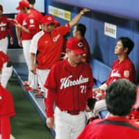 The Carp, seen in the visitors' dugout at Nagoya Dome during their contest against the Dragons on Wednesday, have lost 11 straight games.