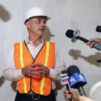 Baseball Commissioner Rob Manfred speaks to the media during a tour of the new Texas Rangers stadium currently under construction in Arlington, Texas, on Tuesday.