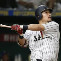Yoshitomo Tsutsugo, seen playing for Japan during the 2017 World Baseball Classic, is one of four NPB stars looking for a home in the majors this offseason.