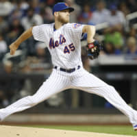 Zack Wheeler, seen pitching for the New York Mets in September, is on the verge of joining the Philadelphia Phillies on a five-year deal, according to sources.
