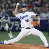 Daisuke Matsuzaka, seen pitching for the Dragons in 2018, will return to the Lions for the 2020 season.