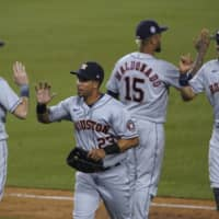 The Astros celebrate a win over the Dodgers on Saturday in Los Angeles. | AP
