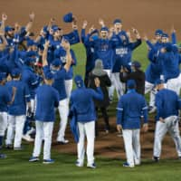 The Blue Jays celebrate on the mount after clinching a playoff spot with a win against the Yankees on Thursday in Buffalo, New York. | USA TODAY / VIA REUTERS