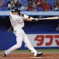 The Swallows' Tetsuto Yamada homers against the Carp during the first inning on Sunday at Jingu Stadium. | KYODO