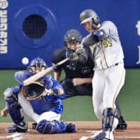 Naomasa Yokawa hits a home run against the Dragons on Sept. 18 in Nagoya. | KYODO