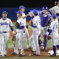 BayStars players celebrate after earning a third straight win over the Giants on Thursday in Yokohama.   KYODO