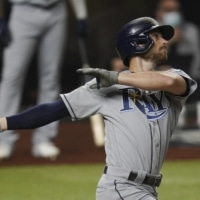 The Rays' Brandon Lowe homers against the Dodgers during the first inning in Game 2 of the World Series on Wednesday in Arlington, Texas.   AP