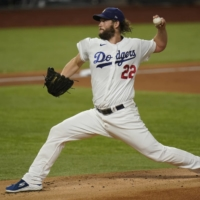 Dodgers starter Clayton Kershaw pitches against the Rays during Game 1 of the World Series in Arlington, Texas, on Tuesday.   AP