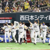Hawks players run out to celebrate after clinching the Pacific League pennant for the first time since 2017 on Tuesday in Fukuoka. | KYODO