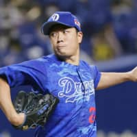 Dragons starter Yudai Ono pitches against the Tigers on Wednesday at Nagoya Dome. | KYODO