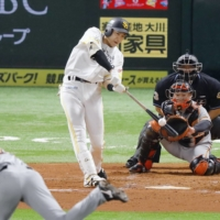 Yuki Yanagita homers against the Giants in Game 4 of the Japan Series on Wednesday.   KYODO