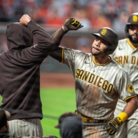 The Padres' Tommy Pham (right) is congratulated after hitting a two-run home run against the Giants in San Francisco on Sept. 26, 2020. | USA TODAY / VIA REUTERS
