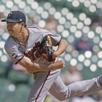 Twins starter Kenta Maeda pitches against the Tigers in Detroit on Wednesday. | AP / VIA KYODO
