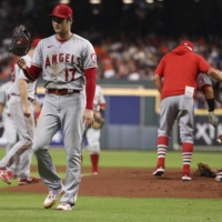 Los Angeles Angels starting pitcher Shohei Ohtani walks off the mound after a pitching change in the fourth inning against the Houston Astros on Friday. | USA TODAY / VIA REUTERS